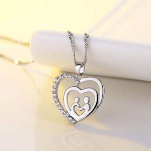 Jewelry - Sterling Silver CZ Heart Mother/Child necklace